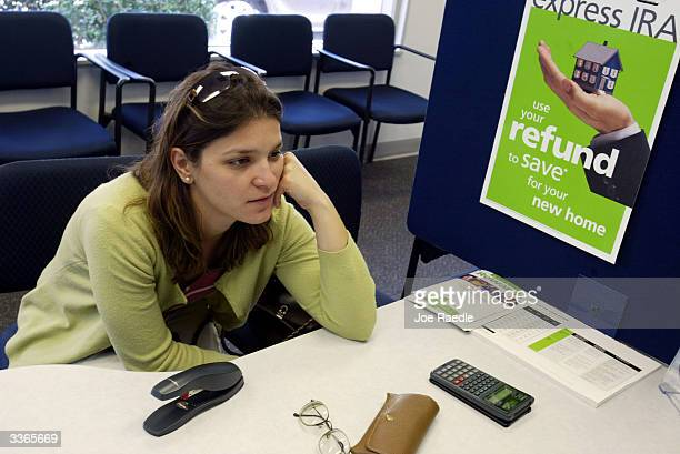 Aida Villamil waits for her tax return to be filled out April 14 2004 at the HR Block office in Coral Gables Florida With only one day to go before...