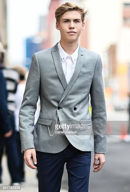 Aidan Alexander is seen outside the Nautica show wearing a striped jacket white shirt and blue pants with white sneakers during New York Fashion Week...
