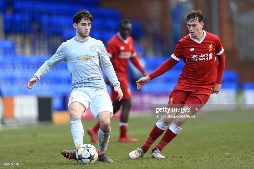 Aidan Barlow of Man Utd battles with Liam Millar of Liverpool during the UEFA Youth League Round of 16 match between Liverpool and Manchester United at Prenton Park on February 21, 2018 in Birkenhead, England.