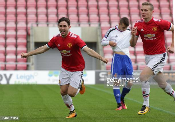 Aidan Barlow of Manchester United U19s celebrates scoring their first goal during the UEFA Youth League match between Manchester United U19s and FC...