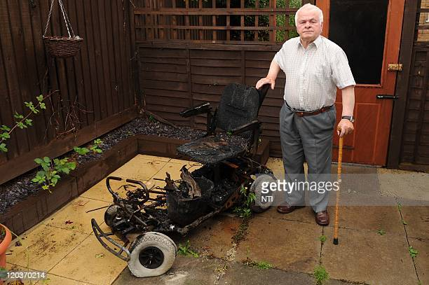 Aidan Cassidy poses with the charred remains of an electric mobility scooter which caught fire while he was on his way to a carboot sale August 4...