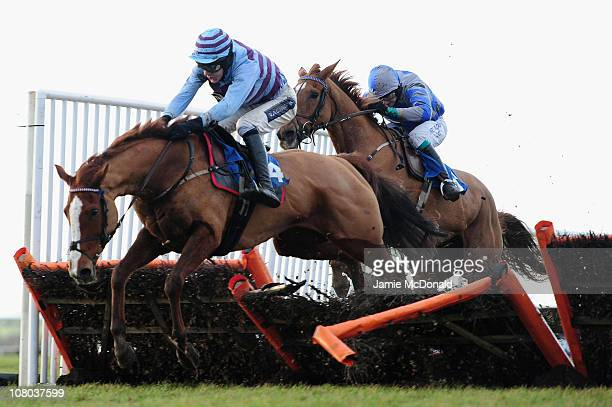 Aidan Coleman rides Vin Rose over the last during the Racing Uk Mares Novices Handicap Hurdle Race run at Huntingdon Racecourse on January 14 2011 in...