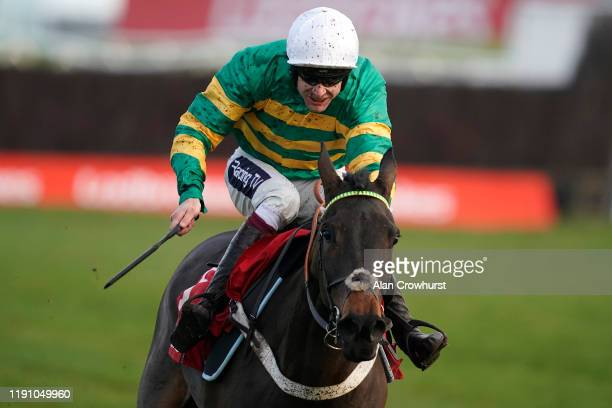 Aidan Coleman riding Epatante clear the last to win The Ladbrokes 'Where The Nation Plays' Intermediate Hurdle at Newbury Racecourse on November 30,...