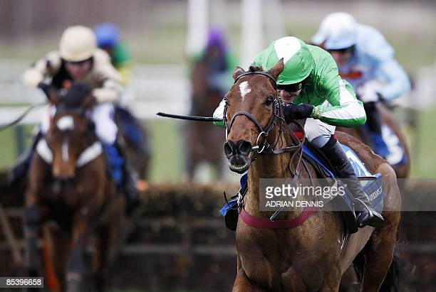 Aidan Coleman riding Kayf Aramis runs to the finishing line after jumping the last fence to win The Pertemps Final Handicap Hurdle race during the...
