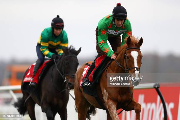 Aidan Coleman riding Ms Parfois tracked by Rachael Green riding Regal Encore during gallops ahead of the Ladbrokes Winter Carnival meeting at Newbury...