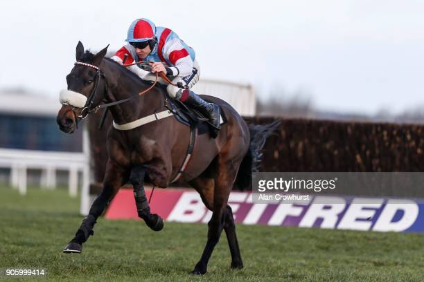 Aidan Coleman riding Saint Calvados clear the last to win The Betfred Mobile Novices' Limited Handicap Chase at Newbury racecourse on January 17 2018...