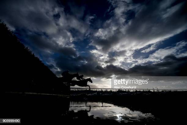 Aidan Coleman riding Saint Calvados clear the water jump before winning The Betfred Mobile Novices' Limited Handicap Chase at Newbury racecourse on...