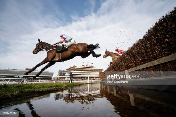 Aidan Coleman riding Saint Calvados clear the water jump on their way to winning The Betfred 'Racing's Biggest Supporter' Novices' Limited Handicap...