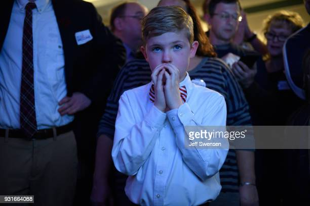 Aidan Davis watches election results at an Election Night event for GOP PA Congressional Candidate Rick Saccone as the polls close on March 13 2018...