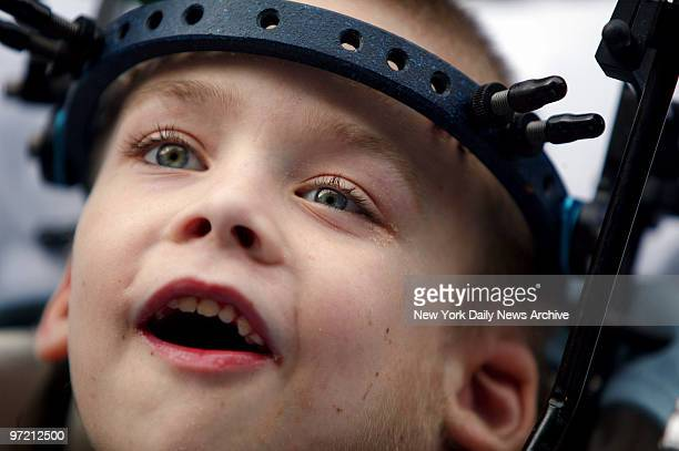 Aidan Fraser beams as he's wheeled out of Montefiore Medical Center on a gurney after a 20day stay following spinal surgery Fraser whose father was...