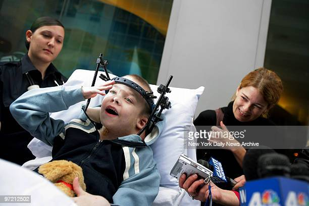 Aidan Fraser is all smiles as he's wheeled out of Montefiore Medical Center on a gurney with mom Suzanne at his side after a 20day stay following...