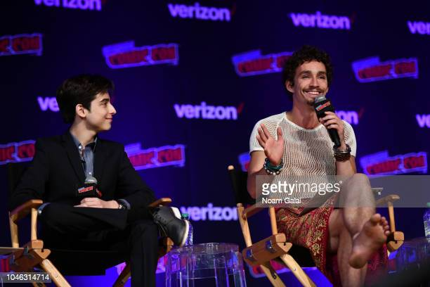 Aidan Gallagher and Robert Sheehan speak onstage at the Netflix Chills panel during New York Comic Con 2018 at Jacob K Javits Convention Center on...