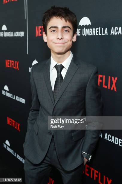 Aidan Gallagher attends the premiere of Netflix's The Umbrella Academy at ArcLight Hollywood on February 12 2019 in Hollywood California