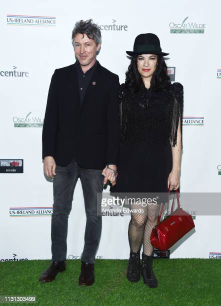 Aidan Gillen and Camille O'Sullivan arrive at the USIreland Alliance 14th Annual Oscar Wilde Awards at Bad Robot on February 21 2019 in Santa Monica...
