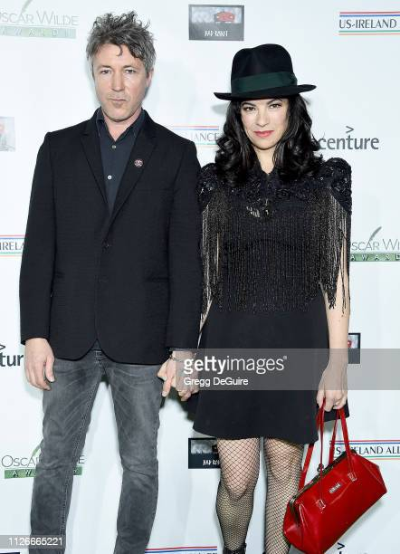 Aidan Gillen and Camille O'Sullivan attend the USIreland Alliance 14th Annual Oscar Wilde Awards at Bad Robot on February 21 2019 in Santa Monica...