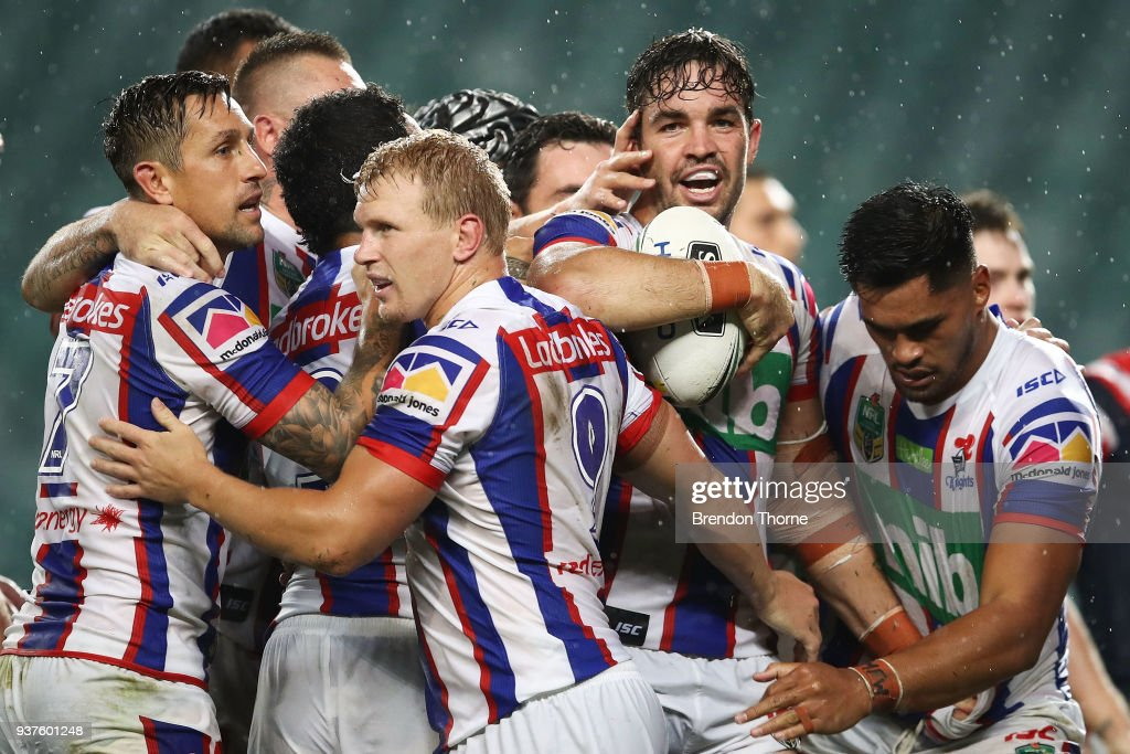 Aidan Guerra of the Knights celebrates with team mates after scoring a try during the round three NRL match between the Sydney Roosters and the Newcastle Knights at Allianz Stadium on March 25, 2018 in Sydney, Australia.