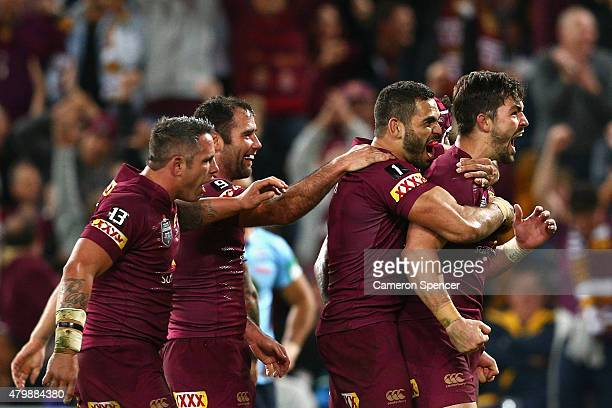 Aidan Guerra of the Maroons celebrates a try during game three of the State of Origin series between the Queensland Maroons and the New South Wales...