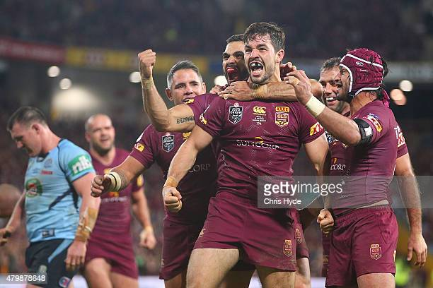 Aidan Guerra of the Maroons celebrates a try with team mates during game three of the State of Origin series between the Queensland Maroons and the...