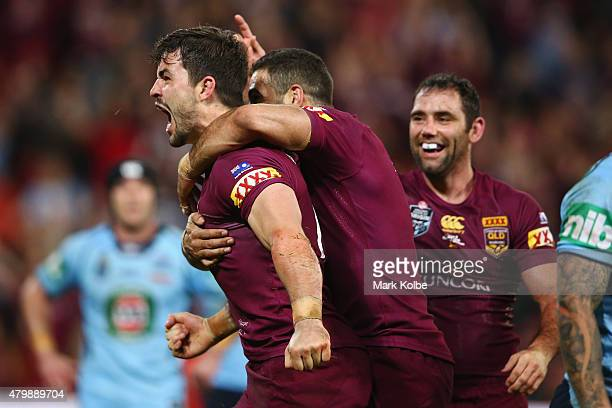 Aidan Guerra of the Maroons celebrates scoring a try during game three of the State of Origin series between the Queensland Maroons and the New South...