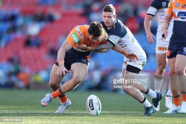 Aidan Guerra of the Newcastle Knights is tackled during the round 15 NRL match between the Newcastle Knights and the North Queensland Cowboys at...
