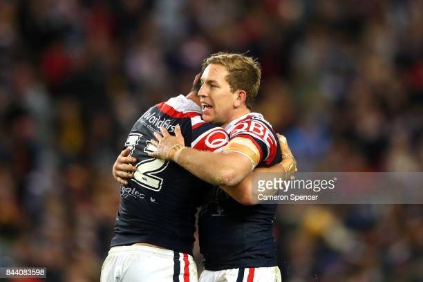 Aidan Guerra of the Roosters and Mitchell Aubusson of the Roosters celebrate winning the NRL Qualifying Final match between the Sydney Roosters and...