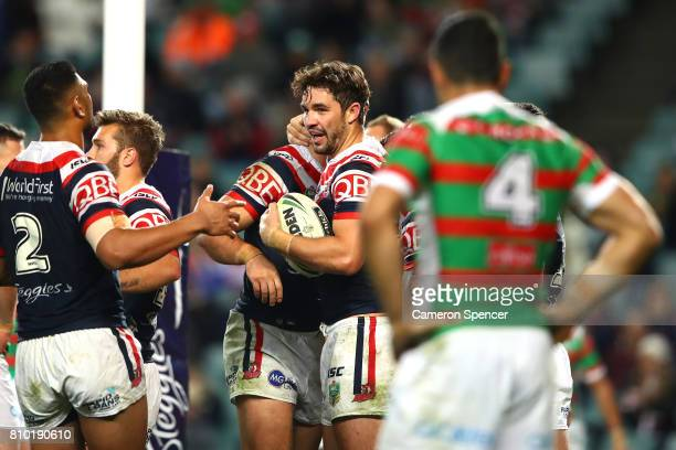 Aidan Guerra of the Roosters celebrates scoring a try during the round 18 NRL match between the Sydney Roosters and the South Sydney Rabbitohs at...