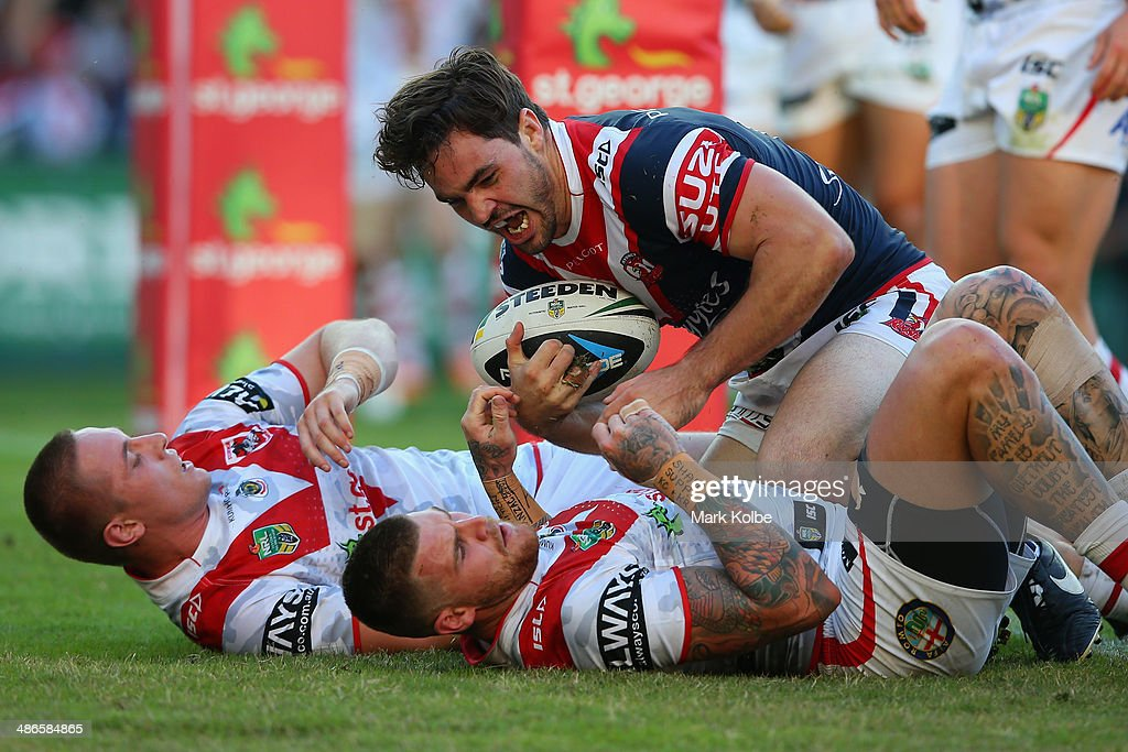 Aidan Guerra of the Roosters celebrates scoring a try during the round 8 NRL match between the St George Illawarra Dragons and the Sydney Roosters at Allianz Stadium on April 25, 2014 in Sydney, Australia.