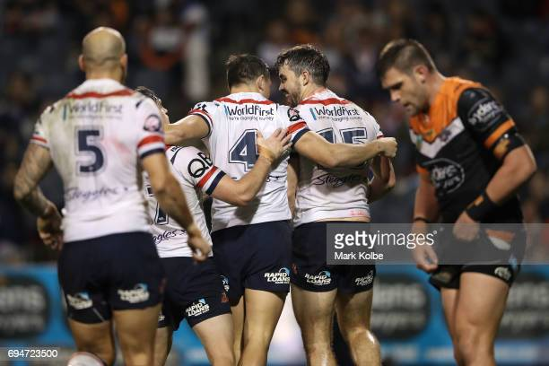 Aidan Guerra of the Roosters celebrates with his team mates after scoring a try during the round 14 NRL match between between the Wests Tigers and...