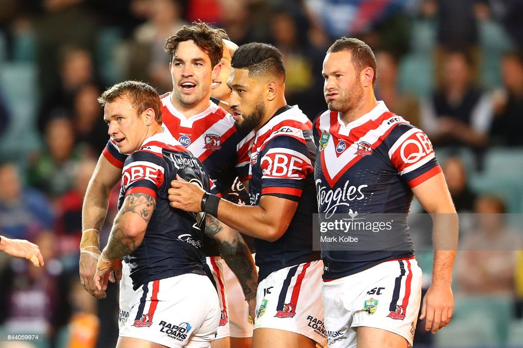 Aidan Guerra of the Roosters celebrates with his team mates after scoring a try during the NRL Qualifying Final match between the Sydney Roosters and the Brisbane Broncos at Allianz Stadium on September 8, 2017 in Sydney, Australia.