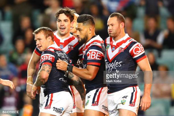 Aidan Guerra of the Roosters celebrates with his team mates after scoring a try during the NRL Qualifying Final match between the Sydney Roosters and...