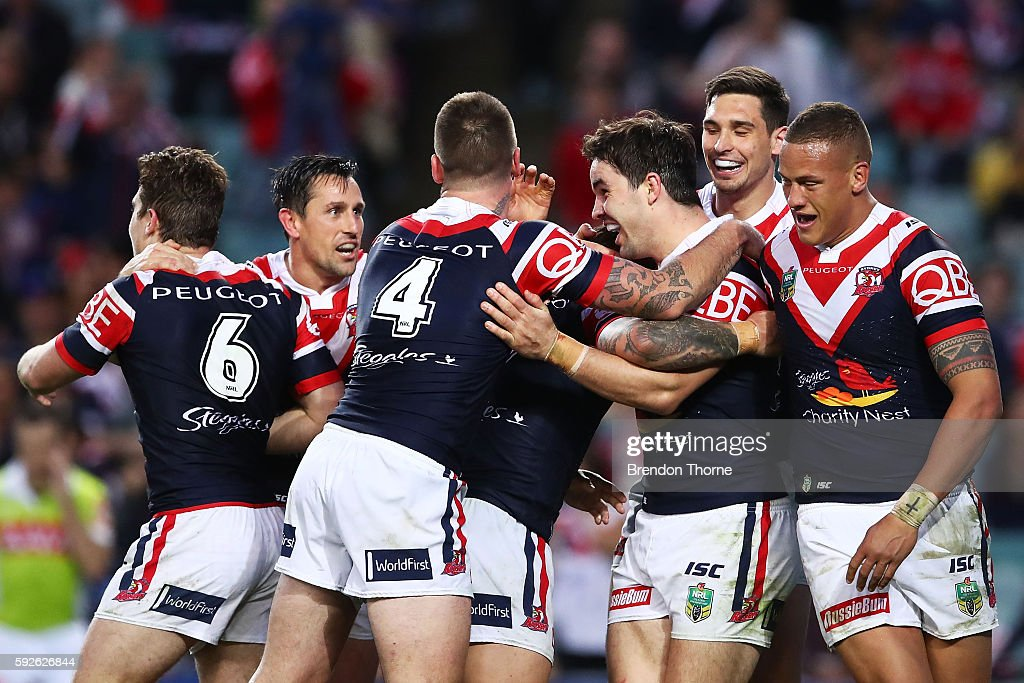 Aidan Guerra of the Roosters celebrates with team mates after scoring a try during the round 24 NRL match between the Sydney Roosters and the St George Illawarra Dragons at Allianz Stadium on August 21, 2016 in Sydney, Australia.