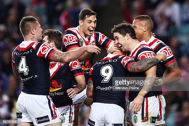 Aidan Guerra of the Roosters celebrates with team mates after scoring a try during the round 24 NRL match between the Sydney Roosters and the St...