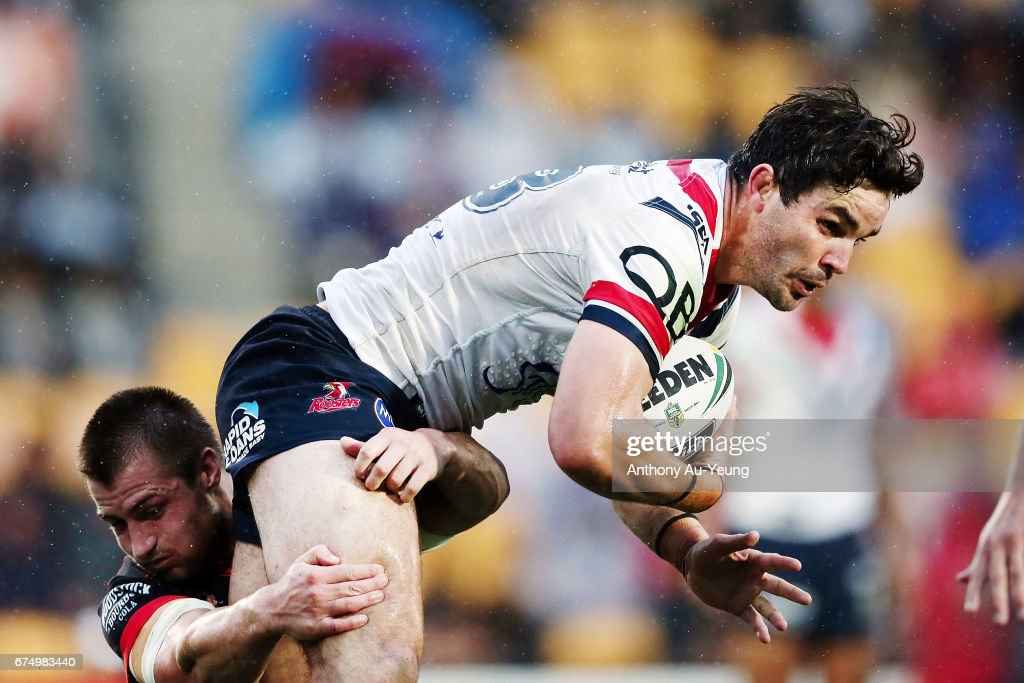 Aidan Guerra of the Roosters is tackled by Kieran Foran of the Warriors during the round nine NRL match between the New Zealand Warriors and the Sydney Roosters at Mt Smart Stadium on April 30, 2017 in Auckland, New Zealand.