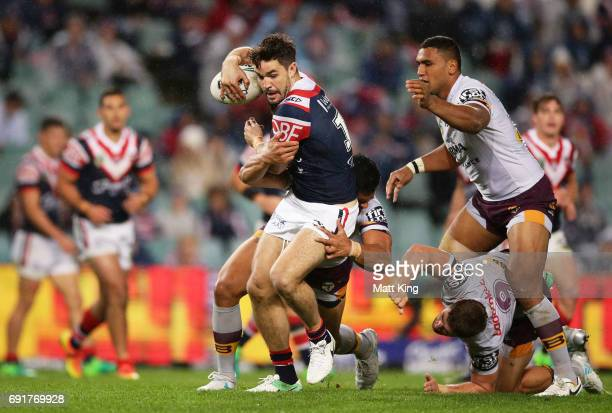 Aidan Guerra of the Roosters is tackled during the round 13 NRL match between the Sydney Roosters and the Brisbane Broncos at Allianz Stadium on June...