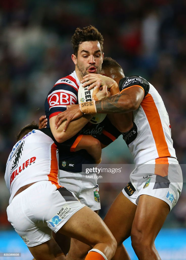 Aidan Guerra of the Roosters is tackled during the round 24 NRL match between the Sydney Roosters and the Wests Tigers at Allianz Stadium on August 19, 2017 in Sydney, Australia.