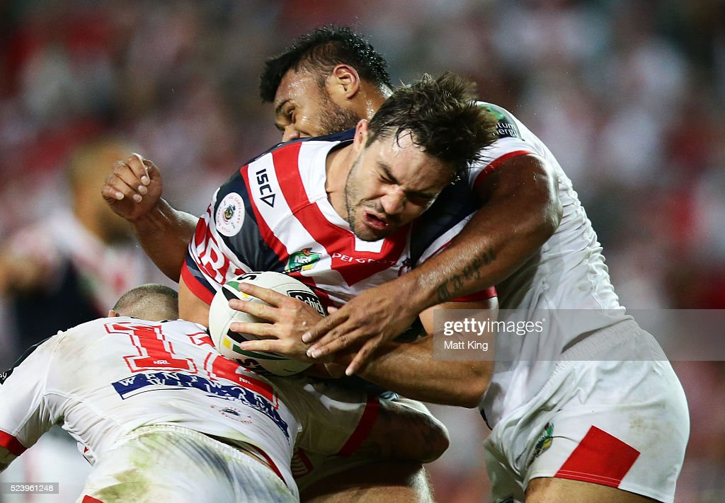 Aidan Guerra of the Roosters is tackled during the round eight NRL match between the St George Illawarra Dragons and the Sydney Roosters at Allianz Stadium on April 25, 2016 in Sydney, Australia.