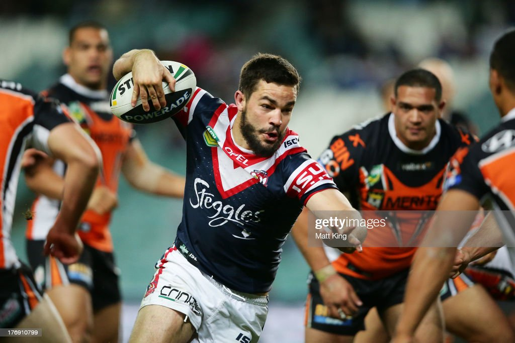 Aidan Guerra of the Roosters takes on the defence during the round 23 NRL match between the Wests Tigers and the Sydney Roosters at Allianz Stadium on August 19, 2013 in Sydney, Australia.