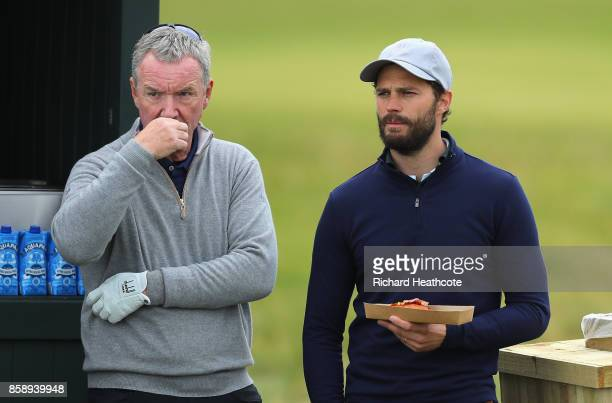 Aidan Heavey and Jamie Dornan Actor take a break during the final round of the 2017 Alfred Dunhill Championship at The Old Course on October 8 2017...