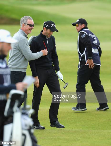 Aidan Heavey congratulates Gregory Bourdy of France on his second shot on the 3rd during the final round of the 2017 Alfred Dunhill Championship at...