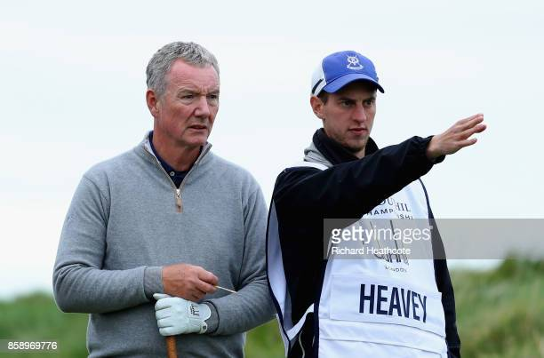 Aidan Heavey speaks with his caddie during the final round of the 2017 Alfred Dunhill Championship at The Old Course on October 8 2017 in St Andrews...