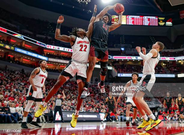 Aidan Igiehon of the Louisville Cardinals battles for a rebound against Evan Clayborne of the North Carolina Central Eagles at KFC YUM! Center on...