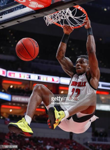 Aidan Igiehon of the Louisville Cardinals dunks the ball during the second half against the North Carolina Central Eagles at KFC YUM! Center on...