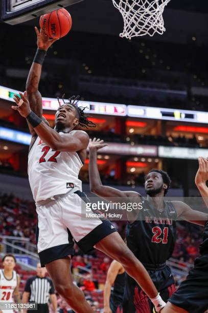 Aidan Igiehon of the Louisville Cardinals shoots the ball during the second half against the North Carolina Central Eagles at KFC YUM! Center on...