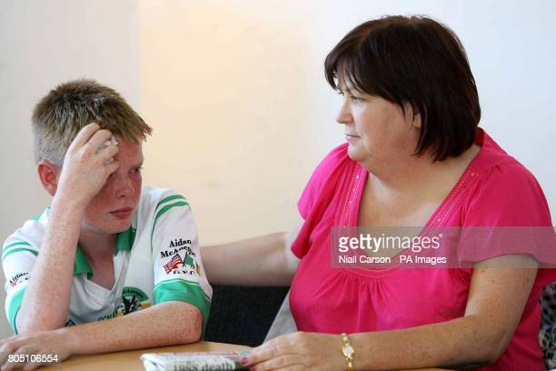 Aidan McAnespie's nephew Ryan and his aunt Margaret during a press conference following the announcement that the British government expressed deep...