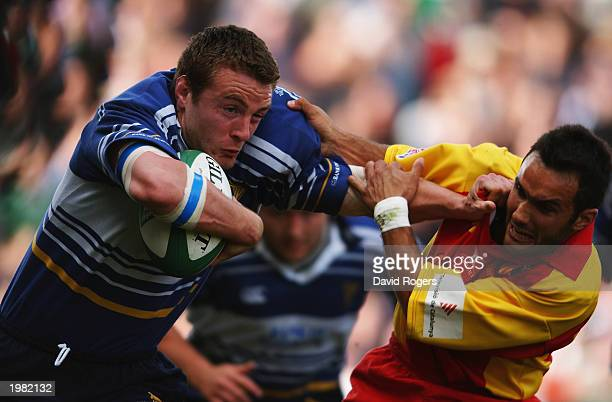 Aidan McCullen of Leinster hands off Frederic Cermeno of Perpignan during the Heineken Cup semi final match between Leinster and Perpignan held on...