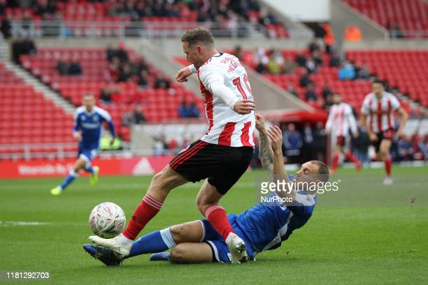 Aidan McGeady of Sunderland in action with Mark Byrne of Gillingham during the FA Cup match between Sunderland and Gillingham at the Stadium Of Light...