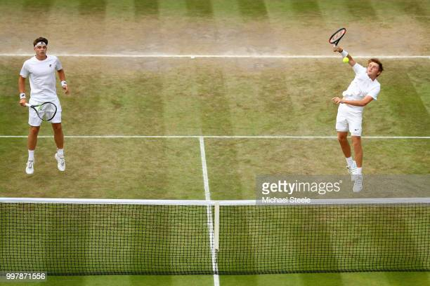 Aidan McHugh of Great Britain and Timofei Skatov of Kazakhstan serve against James Story and Harry Wendelken and Great Britain on day eleven of the...