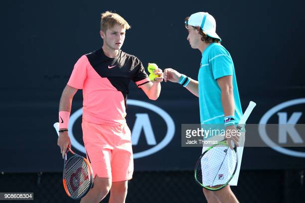 Aidan McHugh of Great Britain and Timofey Skatov of Russia compete in their boy's doubles match against Igor Gimenez of Brazil and Sangeet Sridhar of...