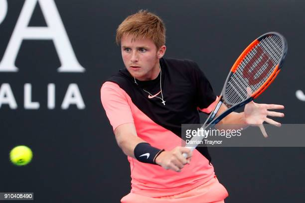 Aidan McHugh of Great Britain plays a backhand against Chun Hsin Tseng of Taipei in the boys' singles semifinal during the Australian Open 2018...