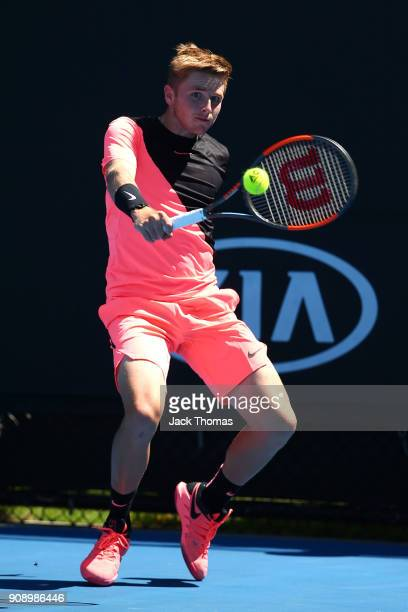 Aidan McHugh of Great Britain plays a backhand against Jamiee Floyd Angele of France during the Australian Open 2018 Junior Championships at...